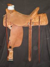 Wade Saddle made by David Rigby. it has a flat plate rigging, semi square skirts, ½ breed with California Poppies