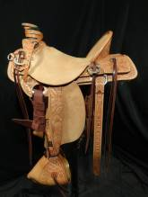 1/2 tooled saddle with additional tooled exposed stirrup leathers, Keepers and Tapaderos