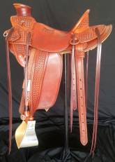1/2 Breed Geometric Pattern Saddle with Double Exposed stirrup leathers. Eight button style saddle. Made by David Rigby for Ian Davis