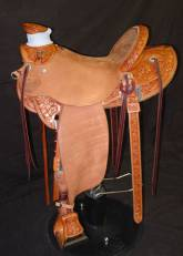 Saddle Built for Mary Brannaman with daffodil tooling. Made by Kent Frecker