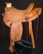 Light weight saddle, in-skirt rigging, half breed wade, weighs 32 pounds. Made by David Rigby