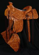 "Full Tooled Selway Packer. 3 ½"" cantle. Rope roll front and cantle. Elephant skin padded seat. 21"" drop tapaderos. Matching saddle bags. Made by David Rigby"