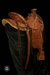 """Full Tooled Selway Packer. 3 ½"""" cantle. Rope roll front and cantle. Elephant skin padded seat. 21"""" drop tapaderos. Matching saddle bags. Made by David Rigby"""