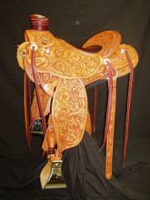 "Mixed Floral Full Tooled Wade Saddle. 4 "" cantle, water buffalo skin padded seat. Silver horn cap. silver cantle concho, and silver string conchos. Made by Kent Frecker"