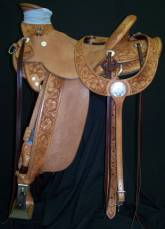 Half breed tooled wade. Exposed stirrup leathers. Made by David Rigby