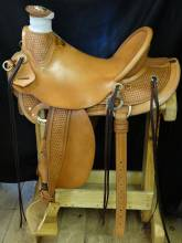 Buckaroo style Basket Stamp with brass hardware. Made by Porter Rix