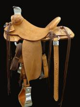 Jayton Lord's Saddle Kent built to ride like a wade, and fit the needs of a reining cow horse and cutter.