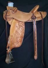 ¾ Tooled Ray Hunt Wade with mixed flowers. Made by David Rigby