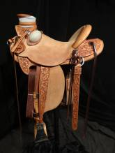 1/2 tooled saddles, with added tooling to the exposed stirrup leathers and Keepers.