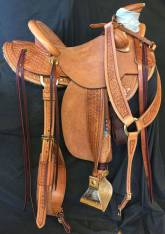 Half Breed Medium sized hamley daisy saddle with exposed stirrup leathers. Made by Karsten Frecker