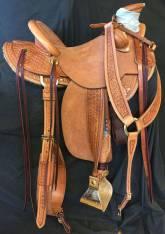 Half Breed Medium sized hamley daisy saddle with exposed stirrup leathers. Made by Karsten Frecker
