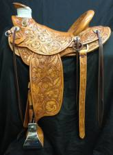 Full mixed floral saddle made by Kent frecker for Bill Barns