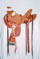 ½ tooled wade daffodil flower; This was a youth size saddle. Made by Kent Frecker