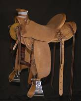 "Wade, 1/2 Breed, 4½"" Horn, Flat Plate Rigging, Basket Floral, Cheyenne Roll, 5"" Monel Stirrups. Made by Kent Frecker"
