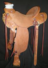 Half Breed Tooled Saddle. Lily and Lavender flowers with humming birds. Made by Kent Frecker.
