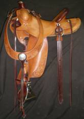 3 Panel Lewis Roper with contrasting leather on horn, cantly binding, and rear cinch and latigo keepers