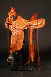 7x Full tooled saddle with inlaid padded seat. Made by David Rigby