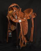 7x mixed flower tooling wade with antique finish with matching headstall and martingale. Made by Kent Frecker