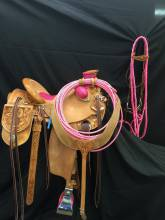 Butterflies and Mixed Floral. Acented with Pink padded seat, bucking rolls, horn wrap, lined stirrups, macate and rope. Made by Karsten Frecker